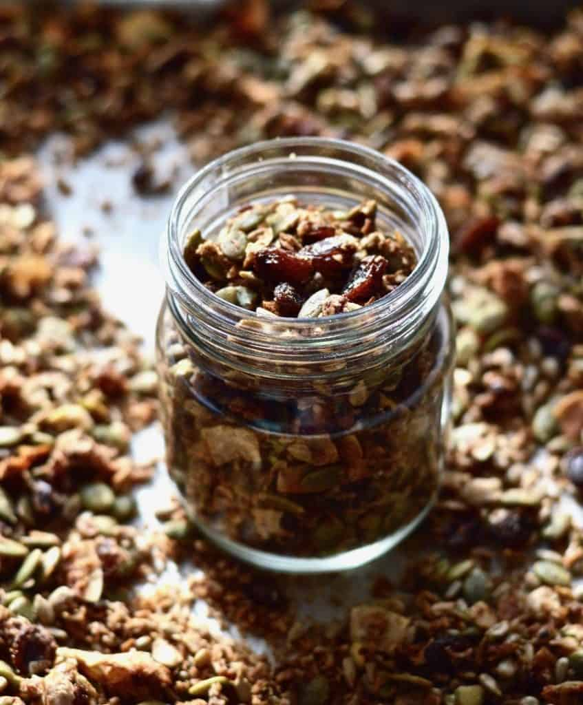 A glass jar full of slightly sweet grain free granola