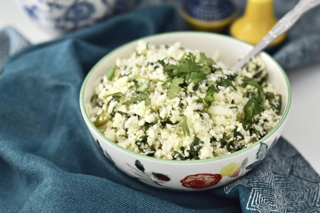 Whole30 Cilantro Lime Cauliflower Rice is such a great alternative to plain cauliflower rice. Because let's be honest, cauliflower rice can be a little boring. But not this Cilantro Lime Cauliflower Rice! This dish is also paleo, AIP and vegan friendly and is incredibly easy to make. Your whole family will love it!#whole30 #cauliflower #rice #paleo #vegan #gaps #aip #sidedish #easy