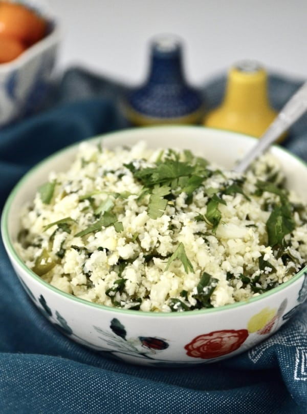 Whole30 Cilantro Lime Cauliflower Rice is such a great alternative to plain cauliflower rice. Because let's be honest, cauliflower rice can be a little boring. But not this Cilantro Lime Cauliflower Rice! This dish is also paleo, AIP and vegan friendly and is incredibly easy to make. Your whole family will love it! #whole30 #cauliflower #rice #paleo #vegan #gaps #aip #sidedish #easy