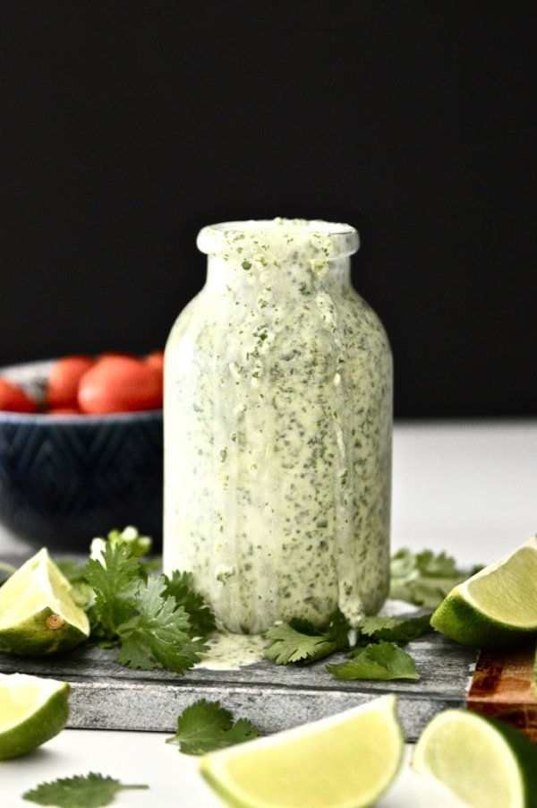 A close up shot of a bottle of Whole30 Cilantro Lime Dressing