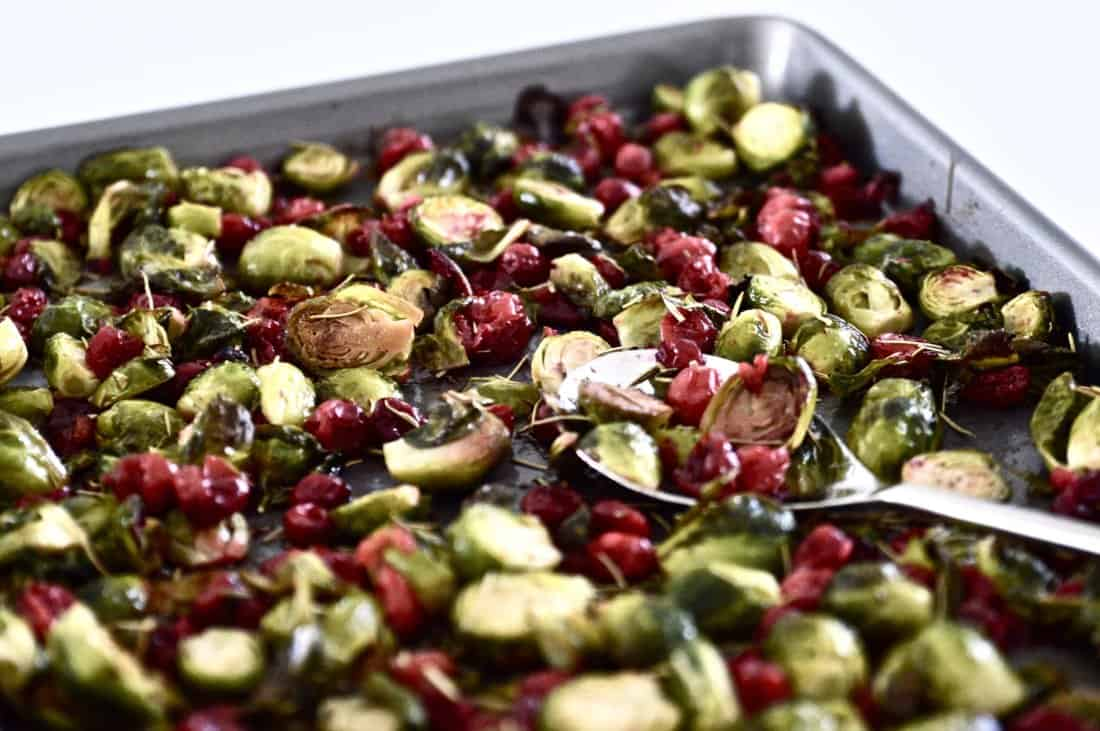 A pan full of roasted Brussels sprouts and cranberries