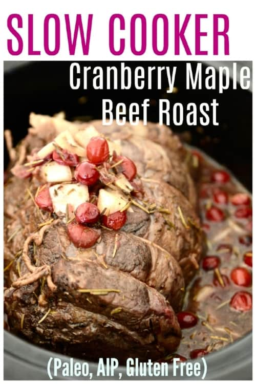 A beef roast in a slow cooker topped with cranberries