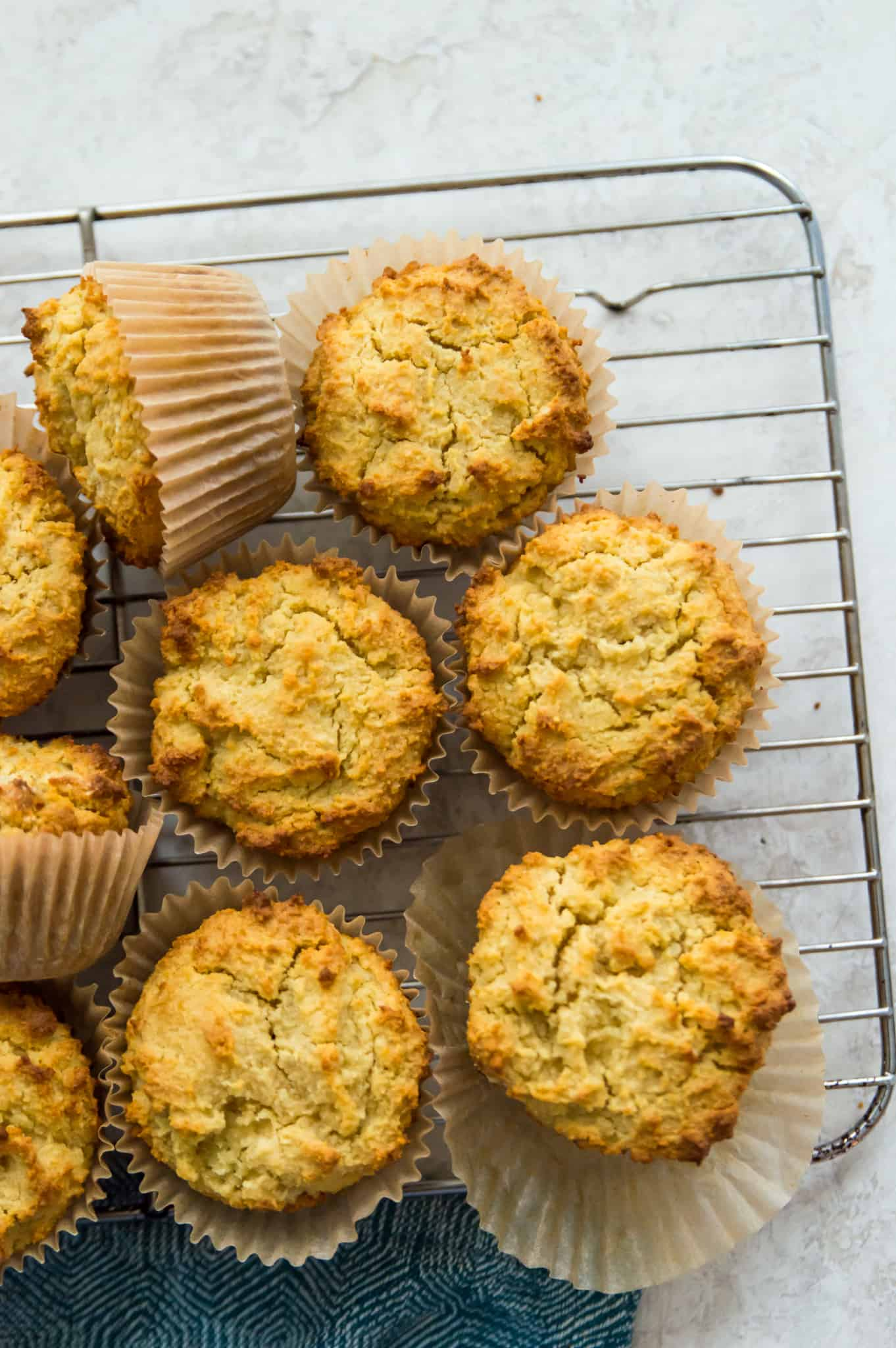 An overhead view of paleo cornbread muffins on a wire rack