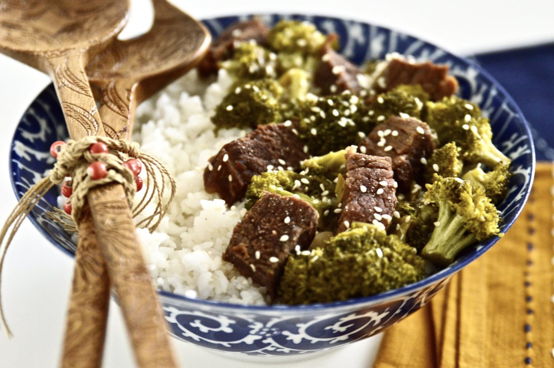 Large bowl of slow cooker beef and broccoli with white rice