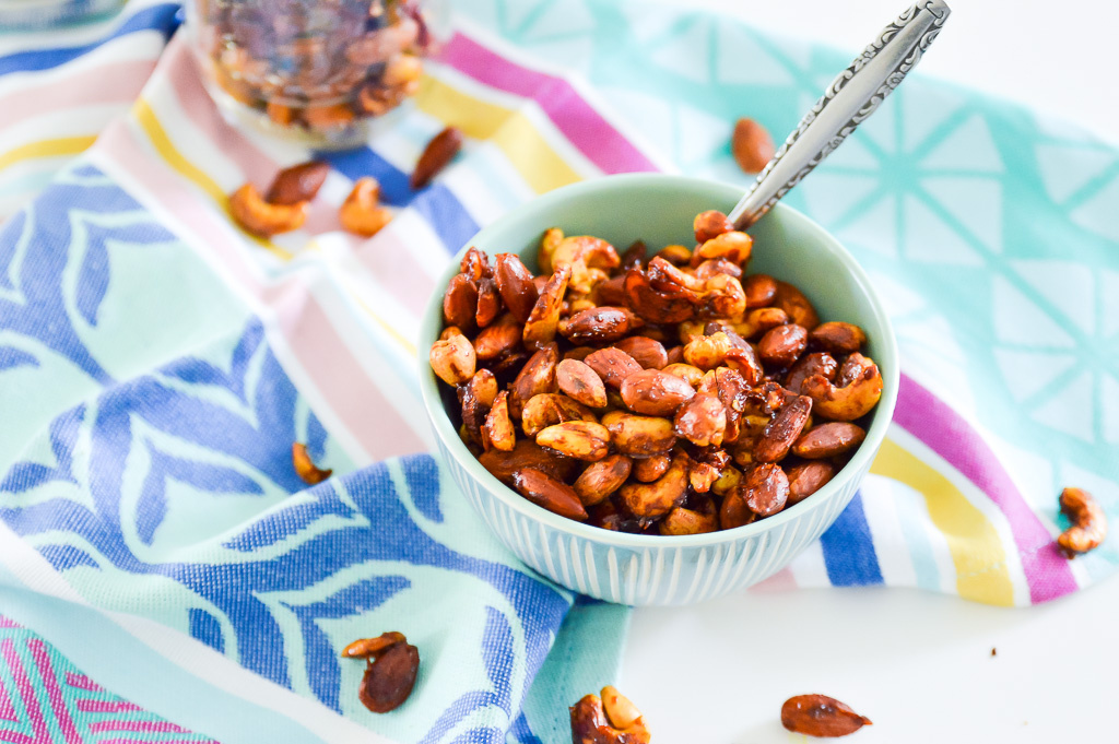 Sweet Curry Cashews and Almonds are going to become your new favourite go to snack. Not only are these Sweet Curry Cashews and Almonds super easy to make but they are the perfect combination of sweet and savoury crunchy goodness. You might even want to make a double batch of these Sweet Curry Cashews and Almonds, they are just that good! #paleo #vegan #snack