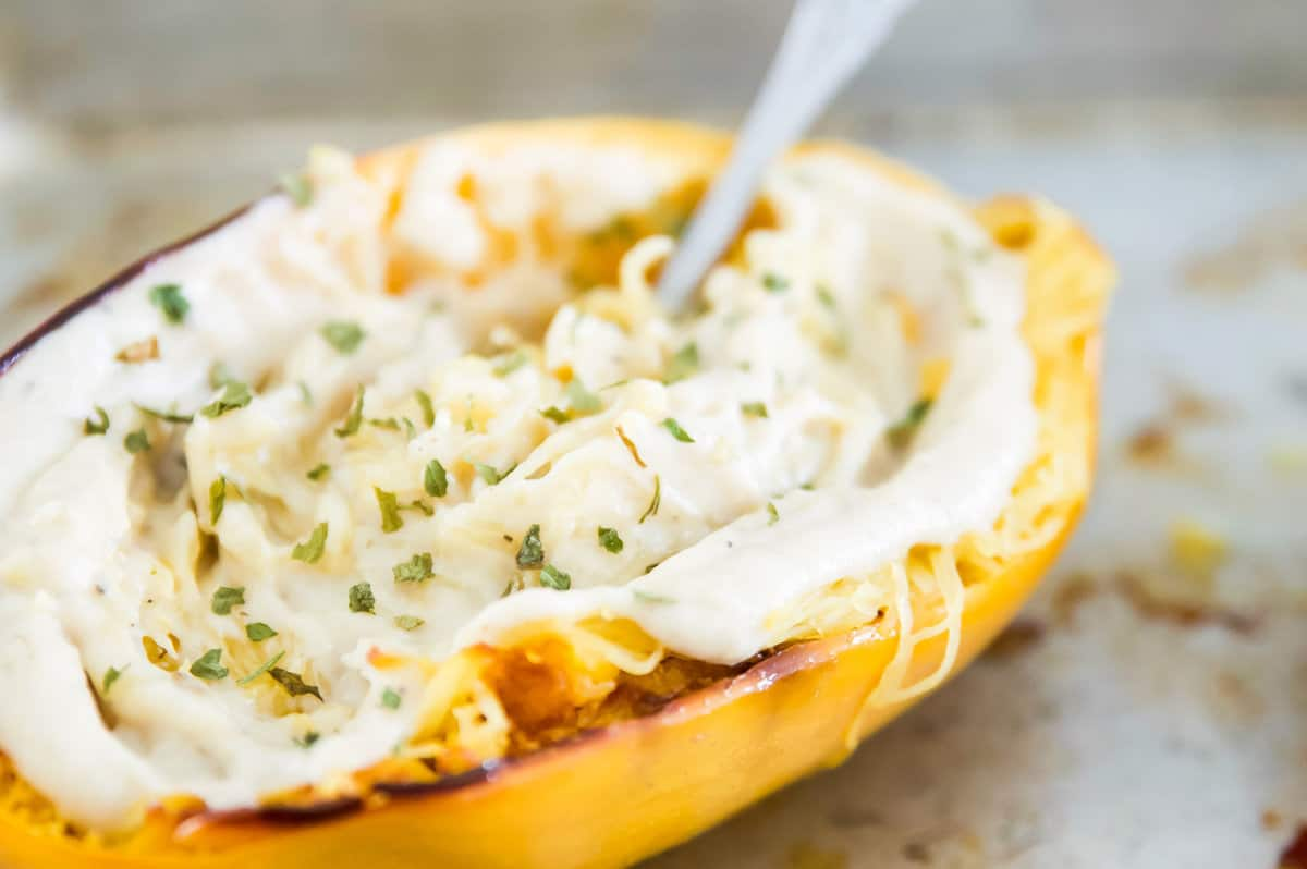 Whole30 Cauliflower Alfredo Sauce in a spaghetti squash