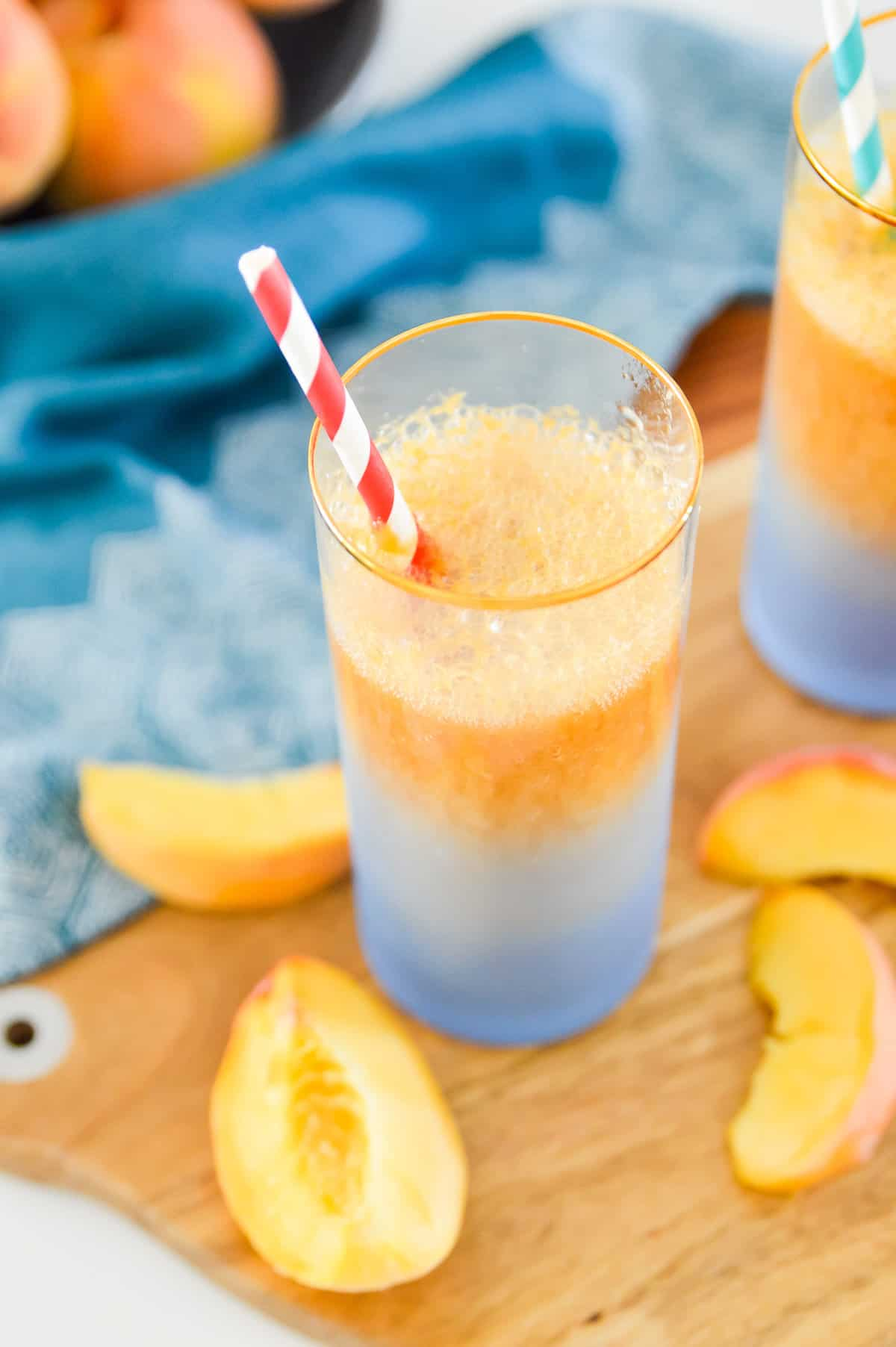 This Peach Ginger Fizz is the perfect summer drink! Made with no added sugars and only 3 ingredients you are going to love this Peach Ginger Fizz. Serve this Peach Ginger Fizz at your next party for an easy, healthy cocktail.