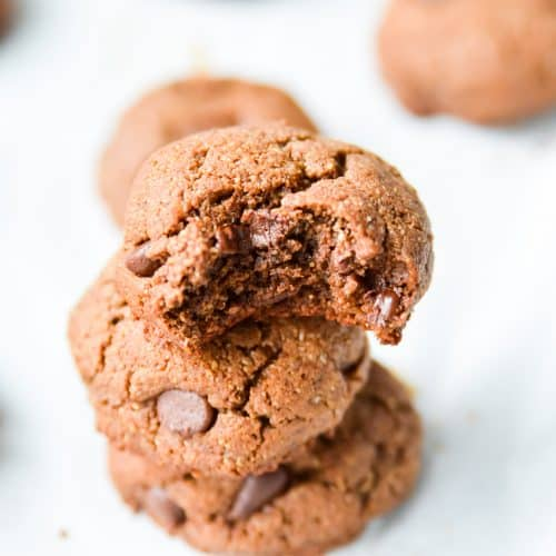 Paleo Double Chocolate Fudge Cookies. Do I even need to say more? These chocolate cookies make the perfect grain free treat. Pair these double chocolate cookies with a glass of dairy free milk and I can't think of anything better! #paleo #cookie #chocolate #glutenfree #dairyfree #fudge #chocolatechip