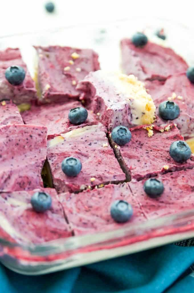 A pan of cut up paleo ice cream bars with berries