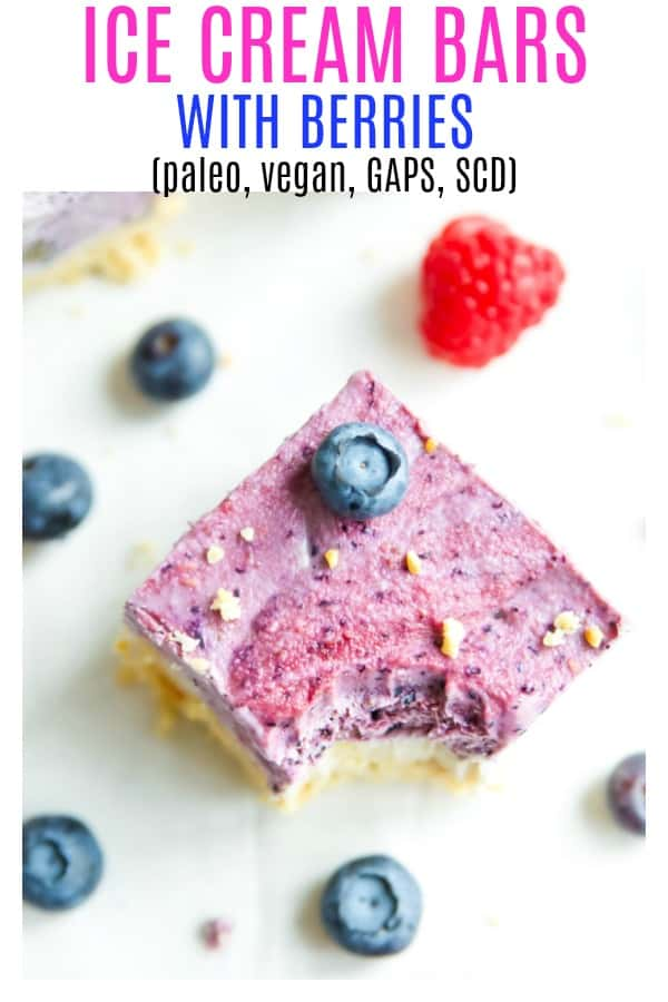 Paleo ice cream bars with berries are going to become your favourite no churn vegan ice cream treat. Easy to make with coconut milk, these dairy free ice cream bars have a vanilla layer and a berry layer with a crunchy crust that is like ice cream cake. #icecream #paleo