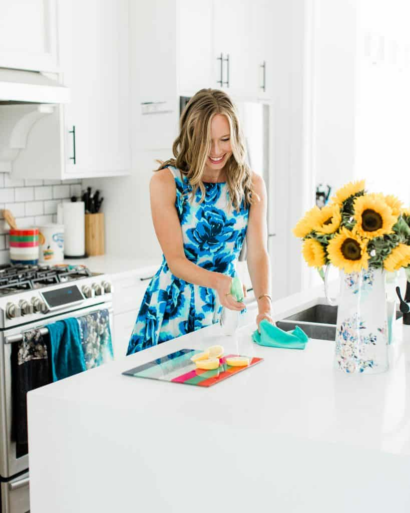 Erin Carter cleaning in the kitchen