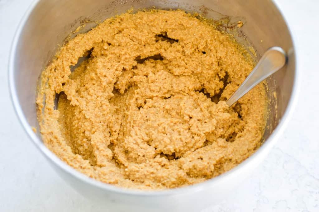 a bowl of batter for gluten free pumpkin muffins