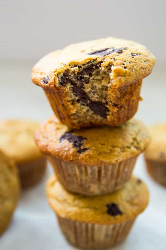 a stack of three banana muffins with chocolate