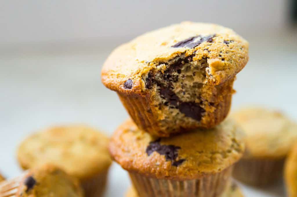 A close up of a banana muffins with chocolate with a bite out of it