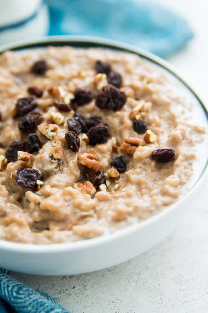 A bowl of rice pudding with raisins and pecans