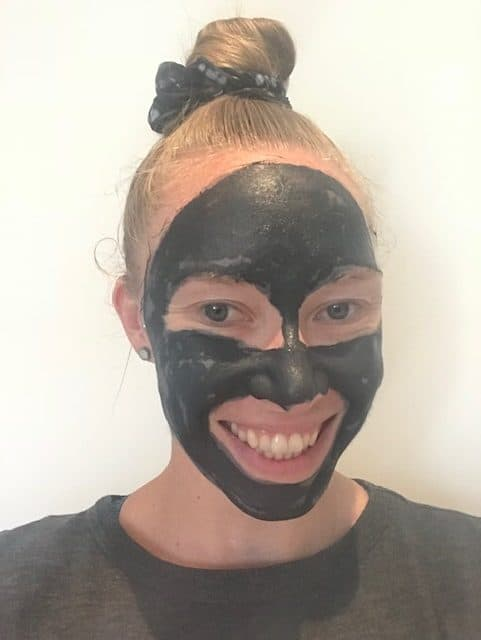 A girl with the Beautycounter charcoal mask on her face