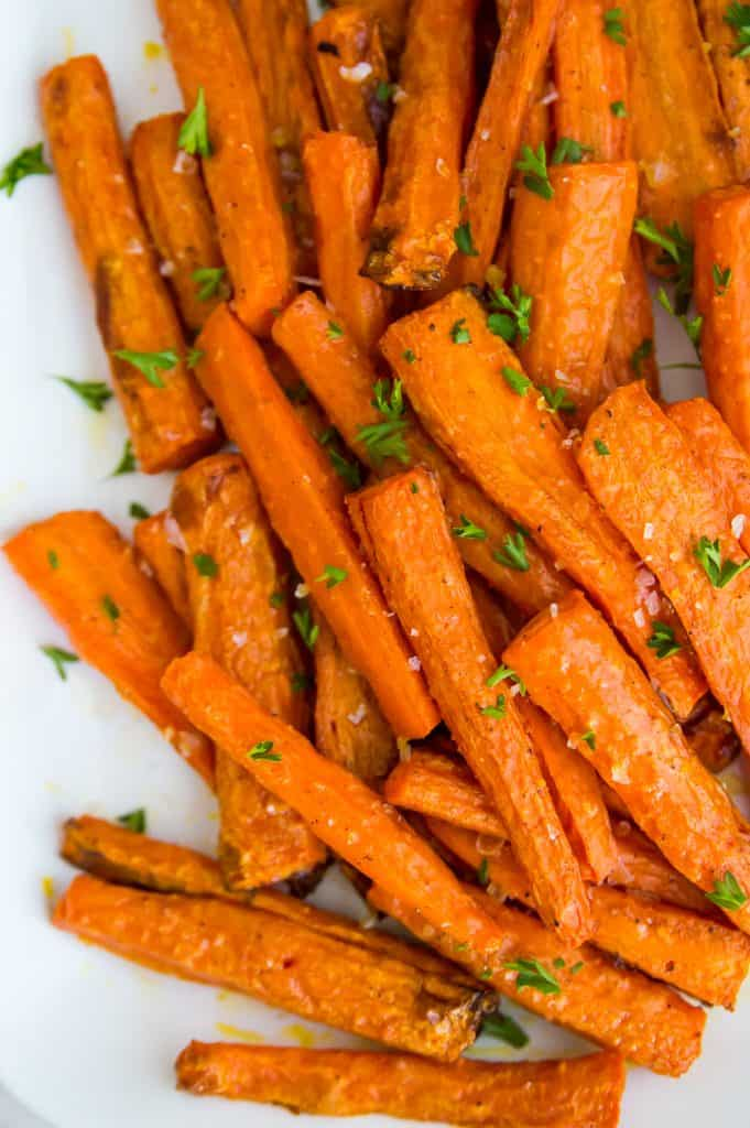 A tray of air fryer carrots with salt and parsley on top