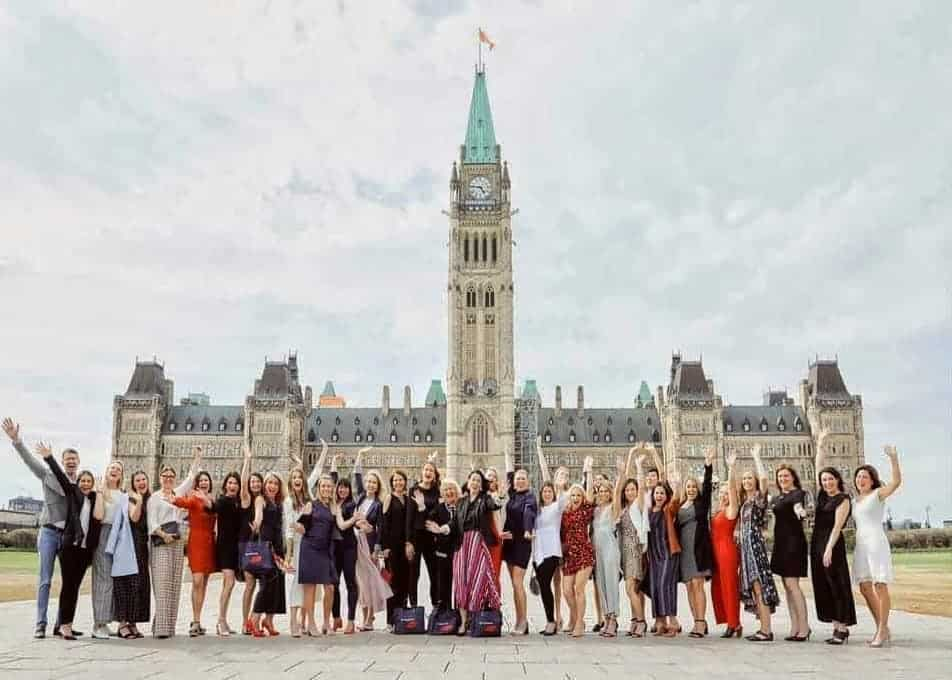 A group of women standing in front of the parliament building