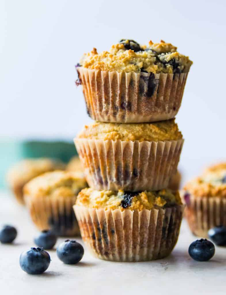 A stack of three blueberry muffins
