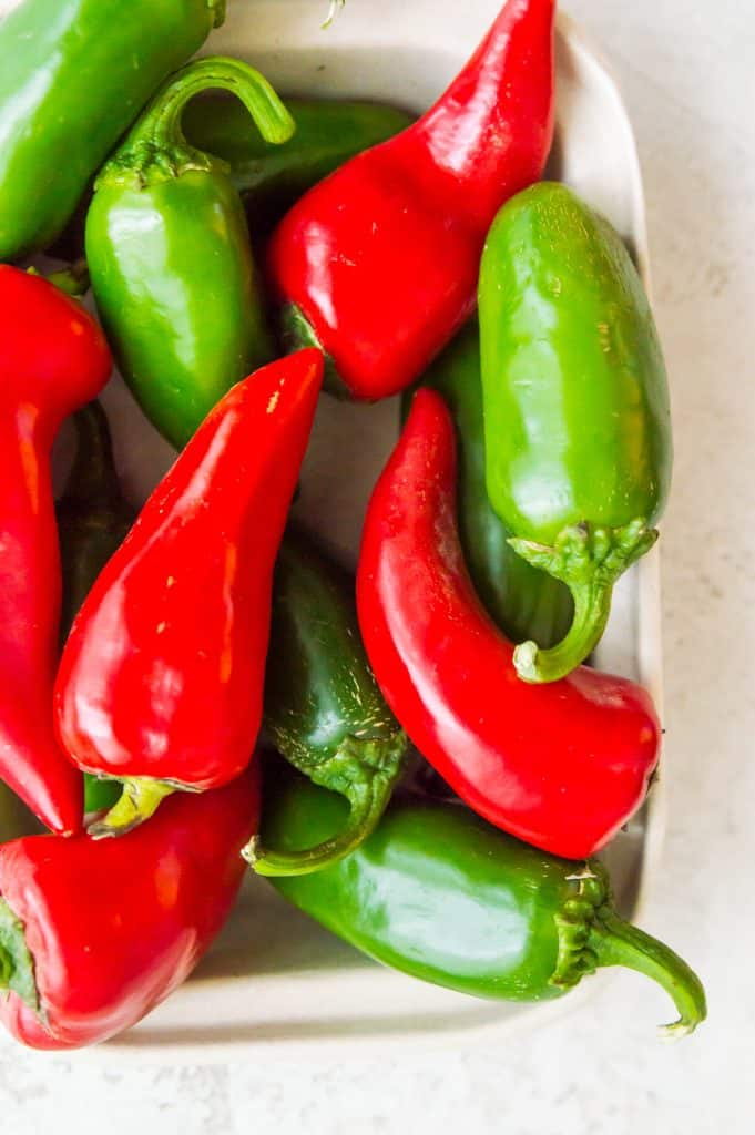 A basket full of red and green chili peppers
