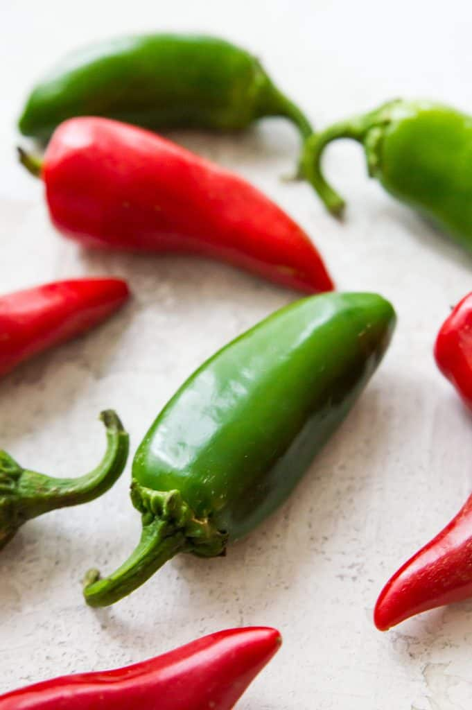 A photo of red and green chili peppers