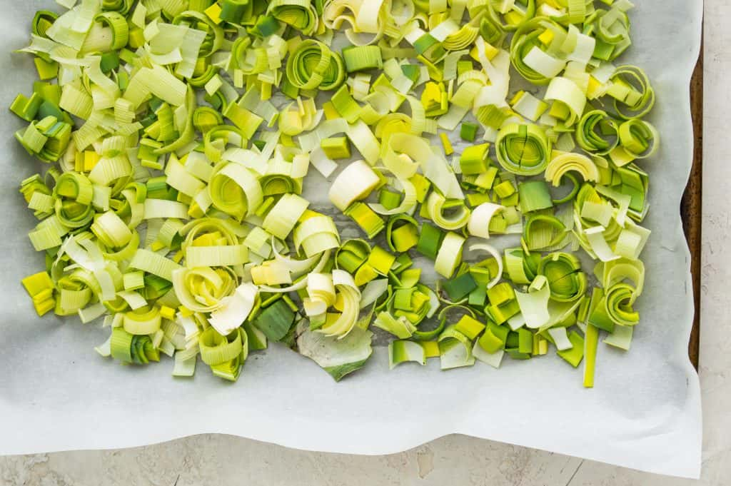 A tray of cut leeks that are going to be frozen