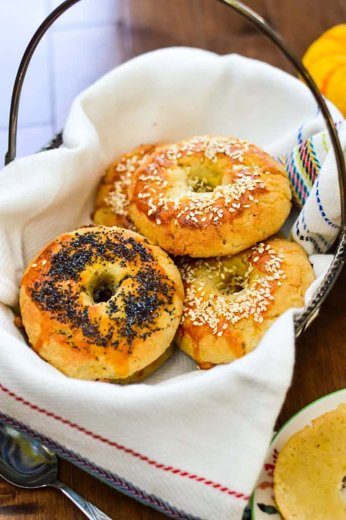 A basket full of paleo bagels topped with sesame seeds