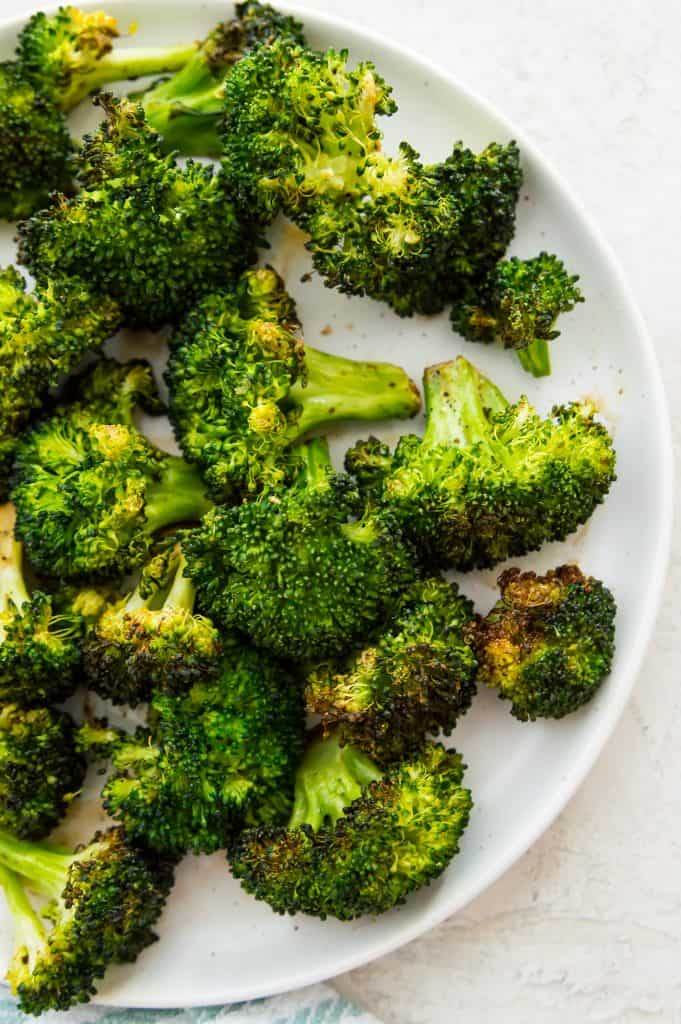 A plate full of broccoli made in the air fryer
