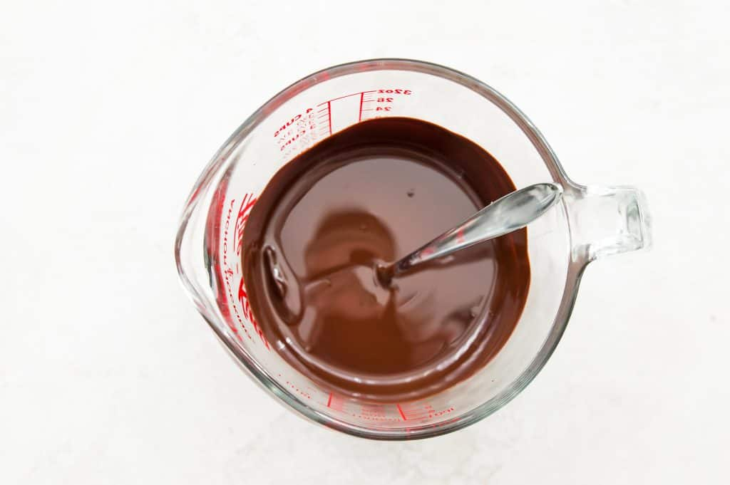 Melted chocolate in a measuring glass