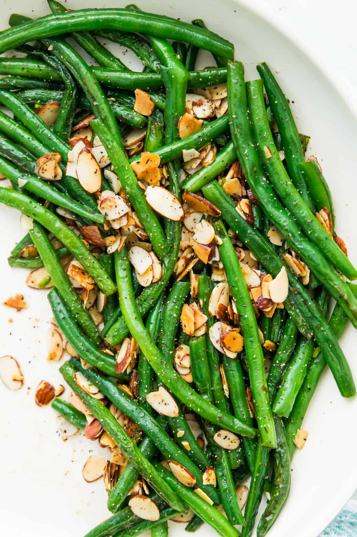 A pan of cooked green beans with roasted slivered almonds   Whole30 Comfort Food
